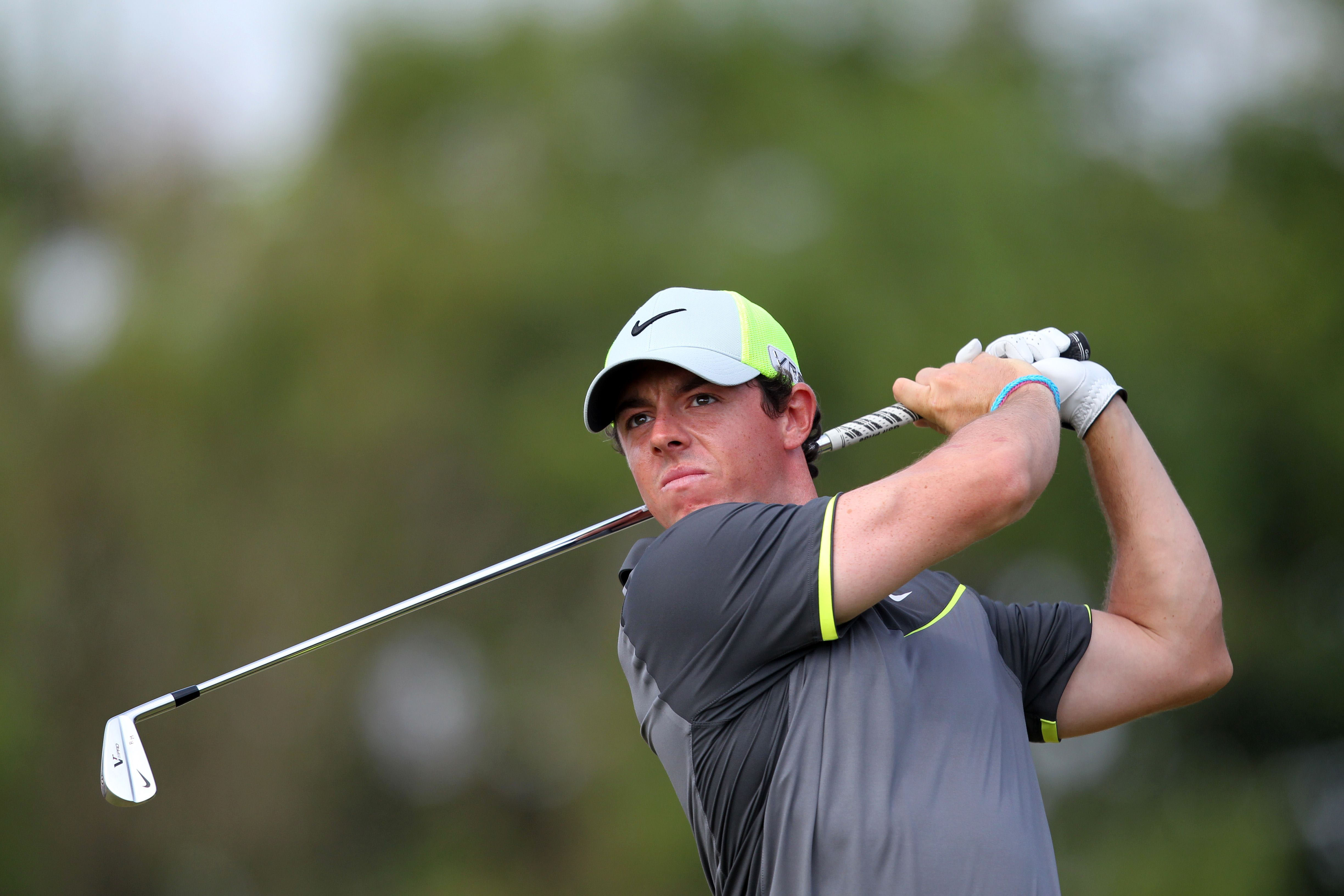 Northern Ireland's Rory McIlroy watches his shot from the 8th tee during his second round, on day two of the 2014 British Open Golf Championship at Royal Liverpool Golf Course in Hoylake, north west England on July 18, 2014. Rory McIlroy went three clear of the field around the turn in his second round at Royal Liverpool on Friday. AFP PHOTO / PETER MUHLY
